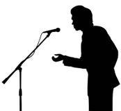 Het silhouettoespraak van de mens aan microfoon Royalty-vrije Stock Fotografie