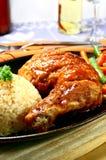 Het sissen van kip Stock Foto
