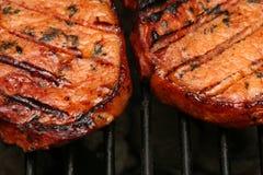 Het sissen van vlees Royalty-vrije Stock Afbeeldingen