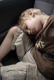 Het slapen in een auto Stock Afbeelding