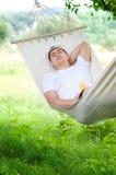 Het slapen op hangmat Stock Afbeelding