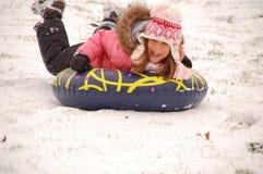 Het sledding van de sneeuw Stock Afbeelding