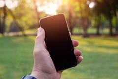 Het slimme telefoon lege scherm in mijn handen Royalty-vrije Stock Foto