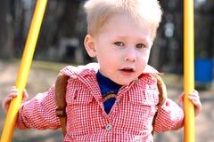 Het Slingeren van Little Boy. Stock Afbeeldingen