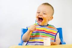 Het slordige Voedsel van Babys om Gezicht Stock Foto