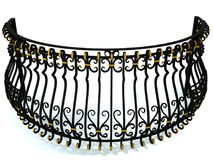 Het smeedijzertraliewerk voor een rond balkon in zwarte verfraaide met gouden die tussenvoegsels op wit worden geïsoleerd 3d geef Royalty-vrije Stock Fotografie