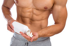 Het smeren van de anabole streptokok van de bodybuilder bodybuilding spieren van het pillenmisbruik royalty-vrije stock afbeelding