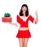 Het sneeuwmeisje houdt de doos van de Kerstmisgift met duimen omhoog ondertekent Royalty-vrije Stock Afbeeldingen