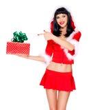 Het sneeuwmeisje houdt gift van het Kerstmis de nieuwe jaar en richt op het Royalty-vrije Stock Fotografie