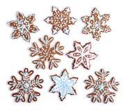 Het sneeuwvlok gestalte gegeven gemaakte huis van peperkoekkoekjes stock afbeeldingen