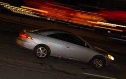 Het snelle onduidelijke beeld van de automotie stock foto's