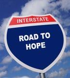 Het snelwegteken geeft richting aan een manier om hoop te ervaren en te hebben royalty-vrije stock foto