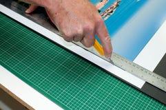 Het snijden van een Af:drukken Stock Foto's