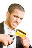 Het snijden van een creditcard royalty-vrije stock foto