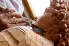 Het snijden van het Standbeeld Stock Foto's