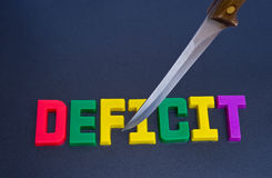 Het snijden van het tekort: effect van recessie. Royalty-vrije Stock Foto
