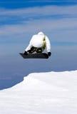 Het snowboarding van de mens op hellingen van Pradollano skitoevlucht in Spanje Stock Afbeelding