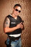 Het Spaanse Cop Kanon van de Holding stock foto's