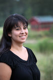 Het Spaanse Glimlachen van de Vrouw Stock Foto