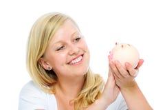 Het spaarvarken van de vrouwenholding Stock Fotografie
