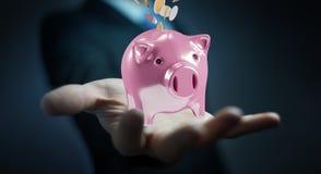 Het spaarvarken van de zakenmanholding met vliegende 3D muntstukken gaande binnenkant Royalty-vrije Stock Foto's