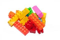 Het speelgoed van kleurrijke kinderen, Plastic bouwstenen stock afbeelding