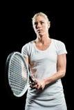 Het speeltennis van de tennisspeler met een racket Stock Afbeelding