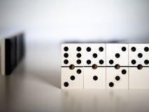 Het spel van de domino Concept stock foto