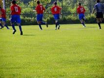 Het spel van de voetbal Stock Foto's