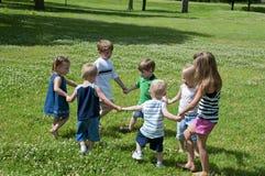 Het spel van het kind Stock Foto's