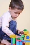 Het spelen met blokken Stock Foto's
