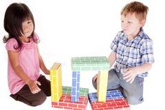 Het spelen met blokken Stock Afbeelding