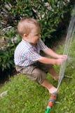 Het spelen met water Stock Foto