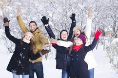Het spelen in Sneeuw Stock Foto's