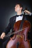 Het spelen van de cello Stock Foto's