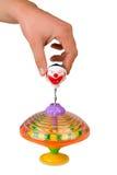 Het spelen van de hand geïsoleerdeh kleurendraaimolen Royalty-vrije Stock Foto