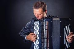 Het spelen van de harmonika stock fotografie