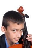 Het spelen van de jongen Cello stock foto