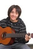 Het spelen van de jongen gitaar Stock Afbeelding