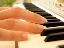 Het spelen van de piano Stock Foto