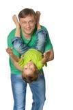 Het spelen van de vader met zijn dochter Stock Foto's