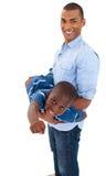 Het spelen van de vader met zijn zoon Stock Fotografie