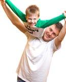 Het spelen van de vader met zoon Stock Foto's