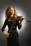Het spelen van de viool. De vrouwenmusicus van de violist Stock Afbeeldingen
