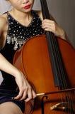 Het spelen van de vrouw cello Stock Fotografie