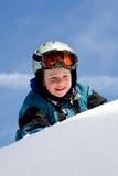Het spelen van het jonge geitje in sneeuw Royalty-vrije Stock Afbeelding
