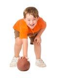 Het spelen van het kind met Amerikaanse voetbal royalty-vrije stock afbeelding