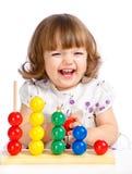 Het spelen van het meisje met ballen stock foto