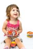 Het spelen van het meisje met haar speelgoed Stock Afbeelding