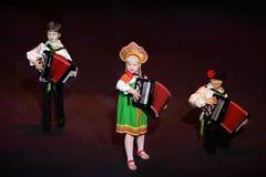 Het spelmuziek van jonge geitjes bij overleg Royalty-vrije Stock Fotografie